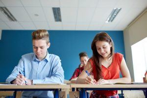 Two teenagers taking a standardized test.