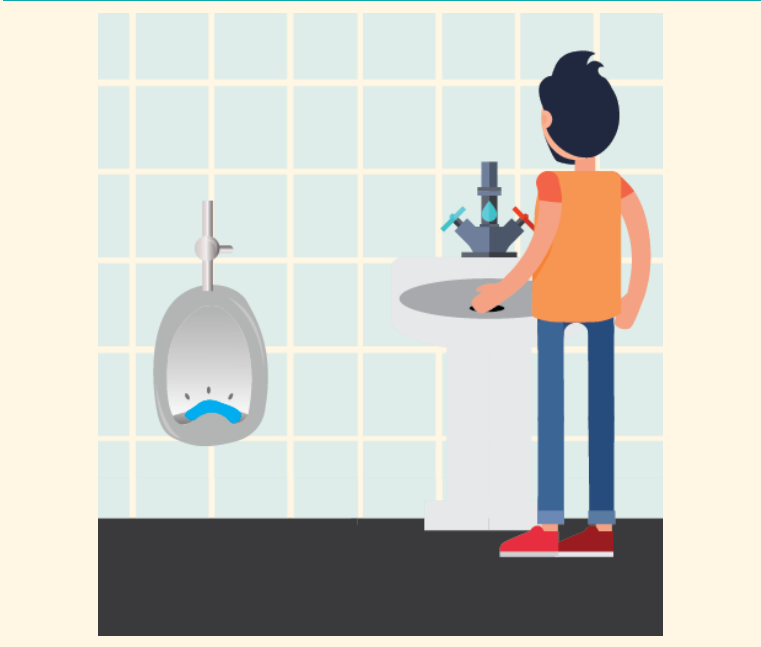 A man washes his hands in the sink next to the urinal.