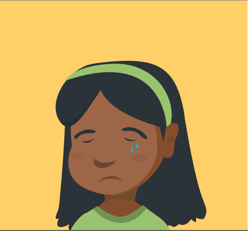 A young girl is crying.
