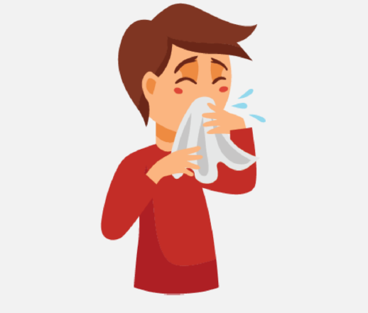 A sick boy covers his cough with a tissue.