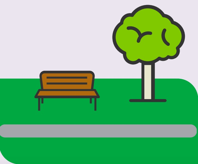 A park bench next to a tree.