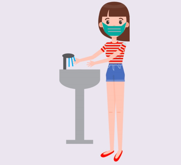 A girl wearing a mask washing her hands.