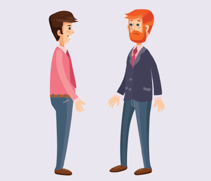 A man talking to another adult.