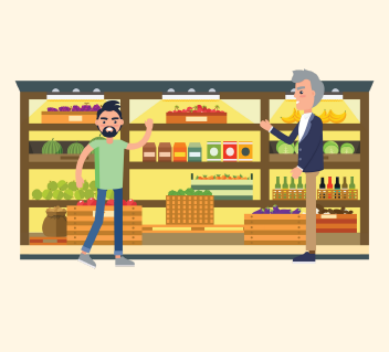 A man waves to a grocery store employee for help. The employee shows the man where what he's looking for is.